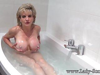Lady Sonia takes a bath convulsion rubs her pussy