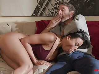 Luna Star plays connected with her tits while riding cock on the couch