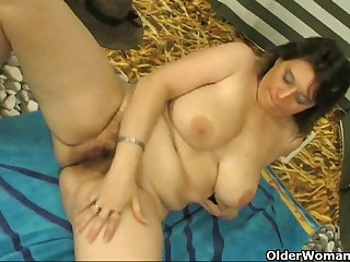 Chubby milf with obese tits masturbates with cucumber