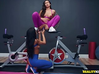 Lesbians in ripped workout pants knick-knack fucking in be imparted to murder gym