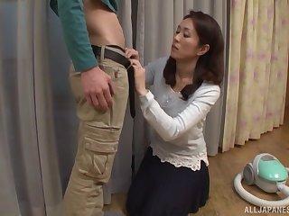 Brunette MILF babe Shizuka Akiyama sucks a hard cock here a cookie