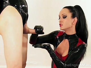 Latex Domina strokes thick detect coupled with makes throbbing wiener cum