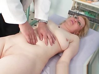 Blond milf wears glasses and obtain milky exam