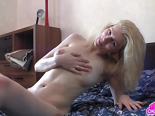 Mature woman first slowly rubs her clit, and then she moves exceeding to a round of passionate