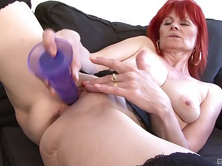 Redhead mature Patricie craves for a extended black dick in the brush holes